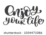 enjoy your life hand drawn text.... | Shutterstock .eps vector #1034471086