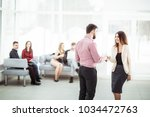 welcome and handshake of... | Shutterstock . vector #1034472763