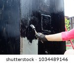 worker waterproofing metal... | Shutterstock . vector #1034489146