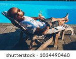 young bearded man in sunglasses ...   Shutterstock . vector #1034490460