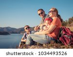 happy family sitting near the... | Shutterstock . vector #1034493526