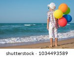 one happy little boy playing on ... | Shutterstock . vector #1034493589
