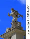 Statue of man with snake in Rome Italy, Villa Borghese - stock photo