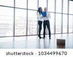 businessman and business woman... | Shutterstock . vector #1034499670
