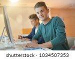portrait of smiling student in... | Shutterstock . vector #1034507353