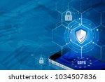 padlock over smartphone and eu... | Shutterstock . vector #1034507836