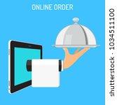 online order concept. hand... | Shutterstock .eps vector #1034511100