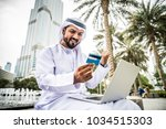 arabic businessman in dubai | Shutterstock . vector #1034515303