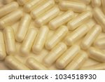 gelatine capsules background | Shutterstock . vector #1034518930