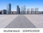 empty floor with modern building | Shutterstock . vector #1034522020