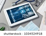 white tablet pc and doctor... | Shutterstock . vector #1034524918