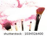 traces of vibrant pink powder... | Shutterstock . vector #1034526400