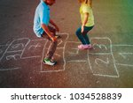 kids playing hopscotch on... | Shutterstock . vector #1034528839
