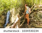 young woman with hiking bag on... | Shutterstock . vector #1034530234