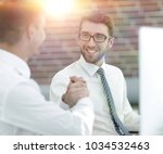 handshake manager and customer... | Shutterstock . vector #1034532463