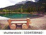 serene scene by the mountain... | Shutterstock . vector #1034538460