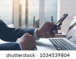 businessman in black suit...   Shutterstock . vector #1034539804
