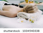 beautiful blond woman relaxing... | Shutterstock . vector #1034540338