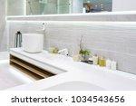 bathroom interior in luxury... | Shutterstock . vector #1034543656