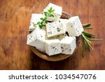 fresh greek feta cheese.... | Shutterstock . vector #1034547076