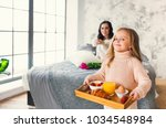 small girl holding tray with... | Shutterstock . vector #1034548984