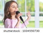 beautiful little girl with...   Shutterstock . vector #1034550730