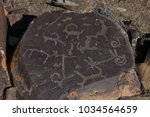 deer stones and petroglyphs of... | Shutterstock . vector #1034564659