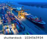 aerial view of containers yard... | Shutterstock . vector #1034565934