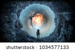 space hole and astronaut. mixed ... | Shutterstock . vector #1034577133