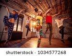 young modern dancing group... | Shutterstock . vector #1034577268