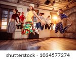 group of young dancer people... | Shutterstock . vector #1034577274
