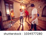 group of young hip hop dancers... | Shutterstock . vector #1034577280