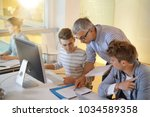 students attending web design...   Shutterstock . vector #1034589358