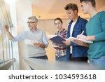 teacher in classroom teaching... | Shutterstock . vector #1034593618