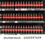 Small photo of SUBANG, MALAYSIA - FEBRUARY 23, 2018: Coke in bottles on row of shelf display for sale in hypermarket grocery store. Coca-Cola, or Coke, is a carbonated soft drink produced by The Coca-Cola Company.