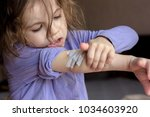 little kid girl with band at... | Shutterstock . vector #1034603920