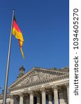 german flag in front of...   Shutterstock . vector #1034605270