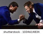 business conflict concept.... | Shutterstock . vector #1034614834