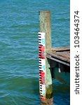 Water Mark Gage on Fishing Pier - stock photo