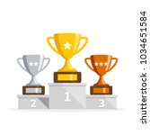 winners podium with cups.... | Shutterstock .eps vector #1034651584