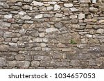 stone wall with medieval... | Shutterstock . vector #1034657053