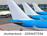 white airplane tails in the... | Shutterstock . vector #1034657536