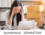 young asian woman stress with... | Shutterstock . vector #1034667244