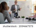 teacher giving economics class  ...   Shutterstock . vector #1034667373