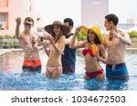 pool party concept  happy group ... | Shutterstock . vector #1034672503
