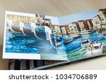 open book with venice image... | Shutterstock . vector #1034706889