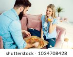 happy modern young couple... | Shutterstock . vector #1034708428