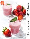 glasses of refreshing... | Shutterstock . vector #1034711626