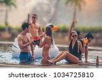 group of friends having fun  in ... | Shutterstock . vector #1034725810