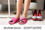 woman in office wearing...   Shutterstock . vector #1034726500